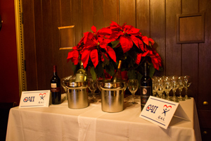 Wine, flowers and signage at the CAII Wine Tasting for Charity event on December 17, 2014 in Tallahassee, Florida