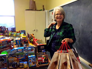 A woman smiles at the 2015 Guardian ad Litem Holiday Gift Drive volunteer shopping and celebration event on Saturday, December 12, 2015 in Tallahassee, Florida