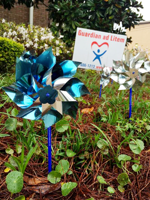 The Guardian ad Litem program's pinwheel garden shines in honor of Child Abuse Prevention month. Pinwheels represent a happy and safe childhood, things the Guardian ad Litem volunteers advocate for every day.