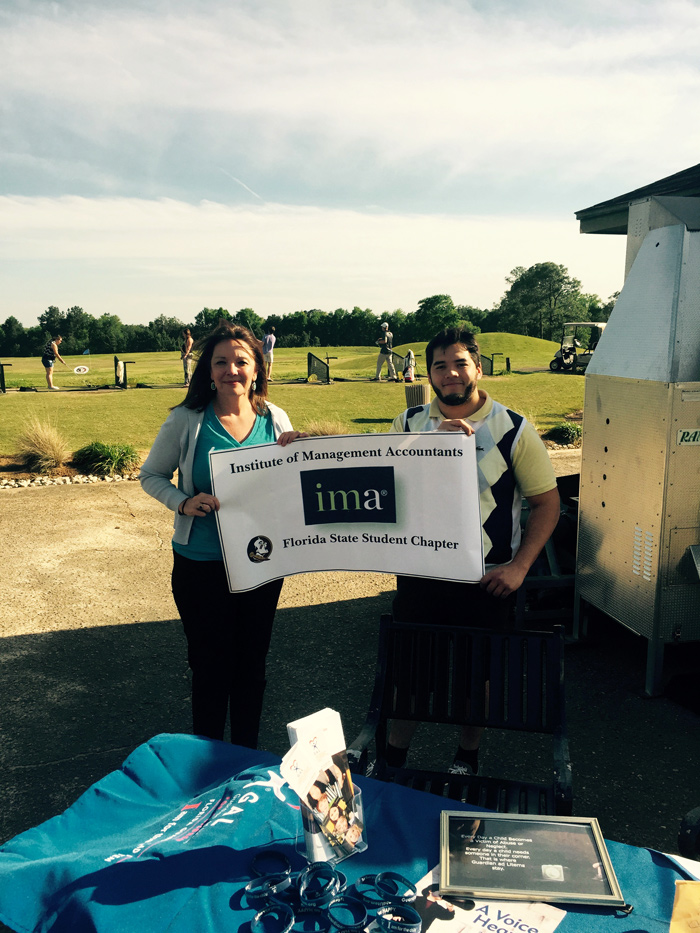 Second Judicial Circuit Guardian ad Litem Program Circuit Director Deborah Moore and a representative of the Institute of Management Accountants (IMA) Florida State University Student Chapter at their IMA Golf Driving Range Fundraiser on April 9, 2016 in Tallahassee, Florida