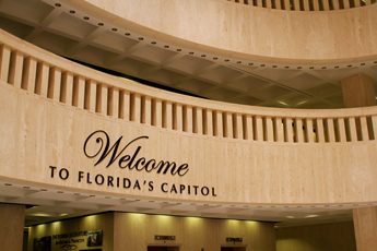 Original Photo Credit: David July/gal2.org --- 'Welcome to Florida's Capitol' sign welcoming visitors entering the rotunda on the east side of the Plaza Level of the Capitol during Guardian ad Litem Day on February 9, 2012 in Tallahassee, Florida.