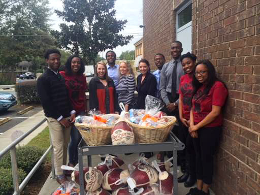 Tallahassee Barristers Association members donating twenty turkeys plus baskets of food to the Second Judicial Circuit Guardian ad Litem Program in November 2017