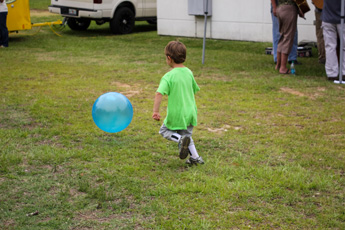 Original Photo Credit: David July/gal2.org --- A little boy chases a blue ball at Guardian ad Litem Appreciation Day on May 12, 2012 in Tallahassee, Florida.