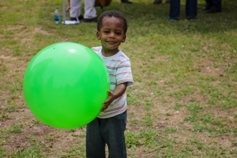Original Photo Credit: David July/gal2.org --- A little boy playing with a big green ball at Guardian ad Litem Appreciation Day on May 12, 2012 in Tallahassee, Florida.