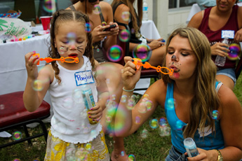 Original Photo Credit: David July/gal2.org --- Payton and Alica blowing bubbles at Guardian ad Litem Appreciation Day on May 12, 2012 in Tallahassee, Florida.