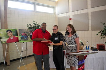 Original Photo Credit: gal2.org/Brian Sealey --- David July (center) accepting the Child Advocates II Board Member of the Year Award from Brian Williams and Deborah Moore at Guardian ad Litem Appreciation Day on May 12, 2012 in Tallahassee, Florida.