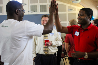 Original Photo Credit: David July/gal2.org --- Brian Sealey gives a high five as David Lloyd looks on after the awards ceremony at Guardian ad Litem Appreciation Day on May 12, 2012 in Tallahassee, Florida.