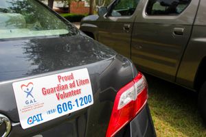 Original Photo Credit: David July/gal2.org --- 'Proud Guardian ad Litem Volunteer' magnet on a car parked at Guardian ad Litem Appreciation Day on May 12, 2012 in Tallahassee, Florida.