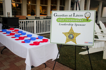 Original Photo Credit: David July/gal2.org --- Raffle selection table and Leon County Sheriff's Office sponsorship sign before the start of the fourth annual CAII golf tournament at SouthWood Golf Club in Tallahassee, Florida on November 2, 2012.