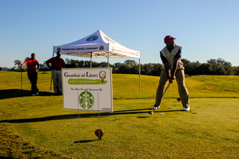 Original Photo Credit: David July/gal2.org --- Representative Alan Williams teeing off at the hole sponsored by Starbucks during the fourth annual CAII golf tournament at SouthWood Golf Club in Tallahassee, Florida on November 2, 2012.