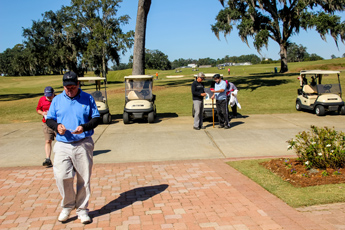 Original Photo Credit: David July/gal2.org --- Players returning to the clubhouse and checking their scores during the fourth annual CAII golf tournament at SouthWood Golf Club in Tallahassee, Florida on November 2, 2012.