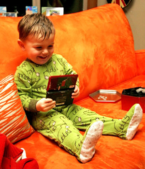 Original Photo Credit: Sean Dreilinger --- while we were distracted by star wars legos, a little green man snuck onto the couch and opened up the big kid's nintendo DS game - _MG_2525