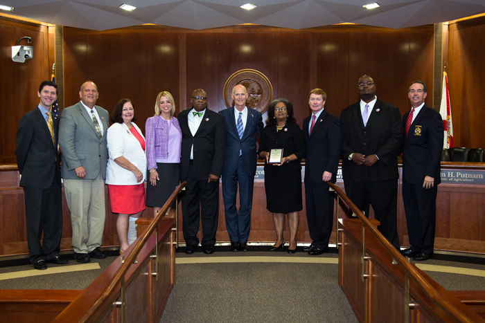 Henry and Charlean Lawton receiving the 'Volunteer Florida Champion of Service Award' with Governor Rick Scott, Attorney General Pam Bondi, Commissioner of Agriculture Adam Putnam, Florida Guardian ad Litem Program Executive Director Alan Abramowitz and others