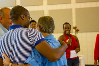 Original Photo Credit: David July/gal2.org --- CAII Board President Brian Sealey congratulates volunteer team leader Stuart Zirin during the awards ceremony at Guardian ad Litem Appreciation Day on June 15, 2013 in Tallahassee, Florida.
