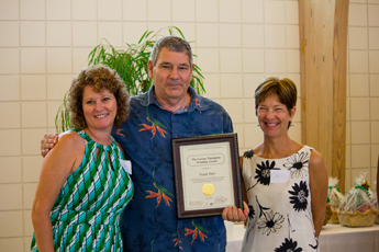 Original Photo Credit: David July/gal2.org --- Volunteer Leigh Merritt, volunteer Frank Platt and Training Coordinator Christine Gornik during the awards ceremony at Guardian ad Litem Appreciation Day on June 15, 2013 in Tallahassee, Florida.