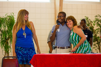 Original Photo Credit: David July/gal2.org --- CAII Board President Brian Sealey introducing volunteers Katherine Blyth and Leigh Merritt during the awards ceremony at Guardian ad Litem Appreciation Day on June 15, 2013 in Tallahassee, Florida.