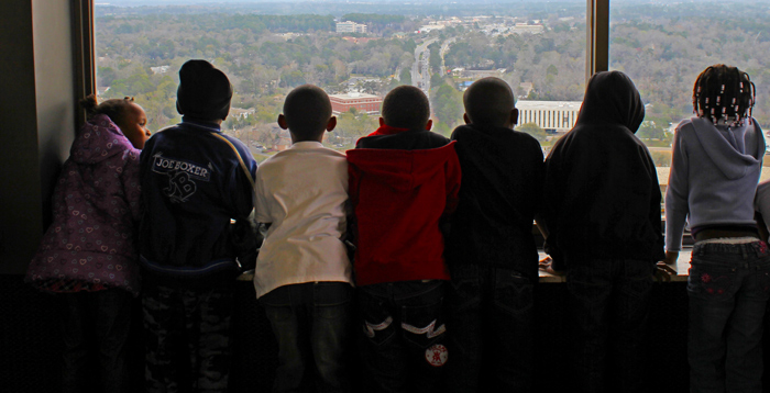 Original Photo Credit: David July/gal2.org --- Children in a tour group look at the eastern view from the twenty-second floor of the Capitol during Guardian ad Litem Day on February 9, 2012 in Tallahassee, Florida.