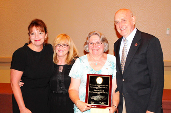 Original Photo Credit: Jan Watford --- Volunteer guardian ad litem Janet 'Jan' Watford (third from left) with Deborah Moore, sister Cookie and husband Jim at the Statewide Guardian ad Litem Program awards reception on August 28, 2013 in Orlando, Florida.
