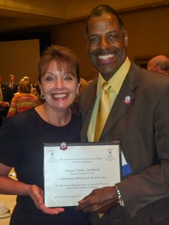 Original Photo Credit: Omega Wynn --- Circuit Director Deborah Moore with volunteer guardian ad litem and community supporter Omega Wynn at the Statewide Guardian ad Litem Program awards reception on August 28, 2013 in Orlando, Florida.