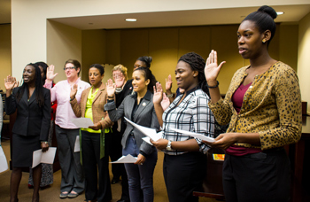 Original Photo Credit: David July/gal2.org --- Volunteers taking the oath administered by Judge Martin Fitzpatrick at the guardian ad litem swearing in ceremony at the Leon County Courthouse in Tallahassee, Florida on October 23, 2013.