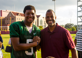 Original Photo Credit: David July/gal2.org --- Volunteer guardian ad litem and community supporter Omega Wynn with Florida State Seminoles quarterback Jameis Winston (5) at the Albert J. Dunlap Athletic Training Facility football practice fields in Tallahassee, Florida on October 8, 2013.