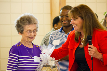 Circuit Director Deborah Moore congratulating volunteer Dorothy Binger during the awards ceremony at Guardian ad Litem Appreciation Day on June 15, 2013 in Tallahassee, Florida.