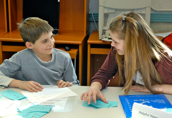 Teens help youngsters with homework after school