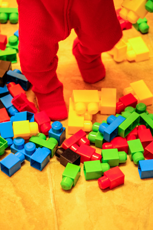 Original Photo Credit: D Sharon Pruitt --- JJ's Building Blocks free creative commons (a child's feet near multi-colored building blocks)