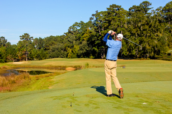 A player teeing off during the fourth annual CAII golf tournament at SouthWood Golf Club in Tallahassee, Florida on November 2, 2012