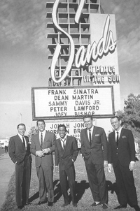 Frank Sinatra, Dean Martin, Sammy Davis, Jr., Peter Lawford and Joey Bishop pictured in front of the Sands Hotel and Casino sign in the 1950s in Las Vegas, Nevada