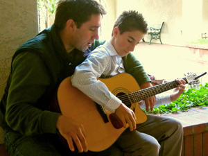 Original Photo Credit: Jason Jacobs --- Learning to Play (man helping a boy learn to play guitar)
