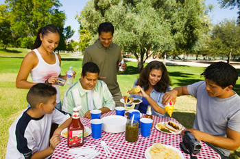 Family Gathered Around Picnic Table