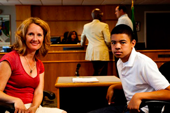 Adult woman and young man in a courtroom